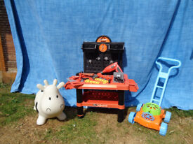 CHILD'S PUSH LAWNMOWER,SIT n BOUNCE COW, TOOLBENCH + TOOLS.