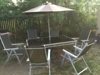 GLASS TOP TABLE 6 CHAIRS AND PARASOL