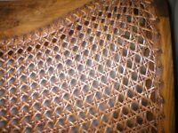 Cane furniture in need of repair