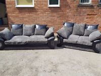 Stunning black & grey jumbo cord sofa suite.lovely design 3 and 2 seaters.1 month old.can deliver