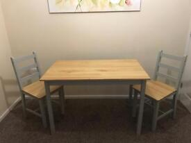 Table and two chairs.