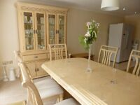 Solid, light-wood extending dining table with 6 chairs and matching cabinet - excellent condition