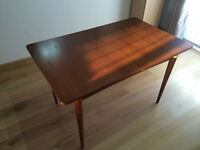 Teak dinning room table for sale excellent condition.
