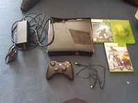 Black xbox 360 with 1 controls and 3 games