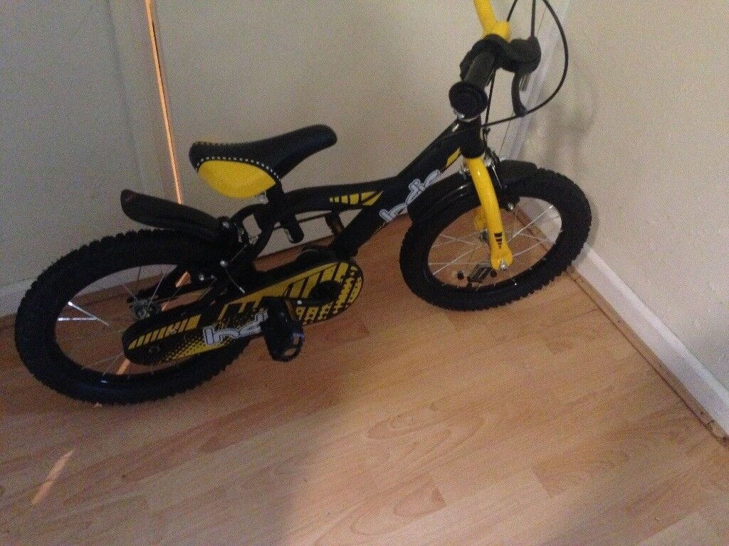 Children's bike comes with stabilisers and helmet if needed