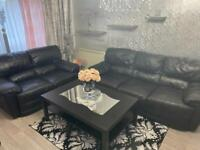 Black leather sofas set 2 and 3 seater can deliver