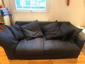 Dark blue sofa and chair with six cushions