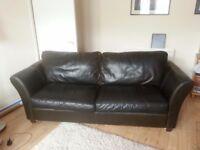 Brown Leather three seat sofa.