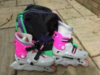 Girls in line skates - adjustable shoe size 3 to 6 with carry bag
