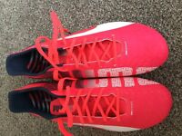 Puma Evo speed football boots - UK size 9 - pink and white in colour