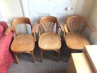 3 wooden chairs with armrests