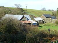 Smallholding 3.2 acres half share house needs finishing.