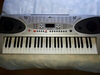 Beginners keyboard for sale with stand