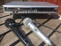 Karaoke DVD - 2 Microphones - 3 DVD's - priced to sell £15