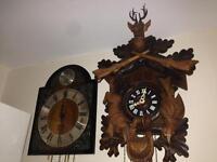 Cuckoo clock and a wag a wall clock