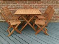Hardwood garden table and chairs brand new