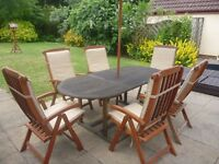 Hardwood extendable garden table, parasol, 6 chairs with cushions