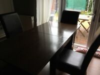 Dining table and 6 chocolate leather chairs for sale