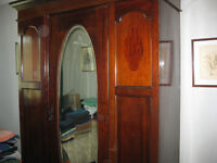 VICTORIAN WARDROBE WITH BEVELLED OVAL MIRROR AND A DEEP DRAWER