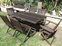 garden table and six folding chairs CAN DELIVER
