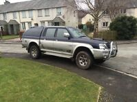 2004 Mitsubishi L200 animal. Blue over silver paint work.