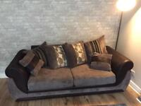 Grey chord sofa and swivel chair