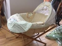 Moses basket, stand and a HUGE pile of bedding