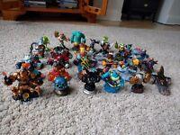 Assorted Skylander and Disney infinity figures