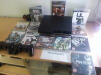 Sony PlayStation 3 Slim 120GB Black Console and 12 games + 2 Controllers