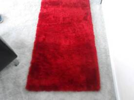 Thick pile, red rug.