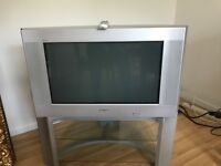 "28"" Silver Sony TV and Stand with remote. Excellent working order."