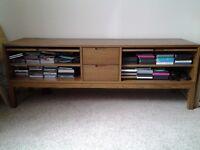 Ikea media storage unit, medium colored wood.