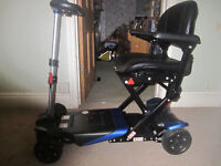 Electronicaly folding mobility scooter, used twice, 6 months warranty