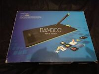 Used. A Wacom Bamboo Pen and Touch graphics tablet