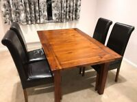Harveys Extendable Dining table and two free chairs