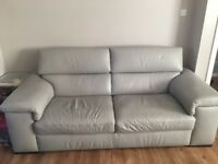 Grey leather 3 seater and 2 seater couch