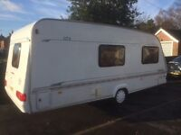 Elddis Typhoon 4 berth caravan with Isabella awning and winter cover