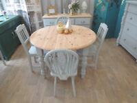 Round pine dining table and four chairs in shabby chic style