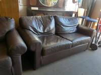 Modern brown twin leather sofas