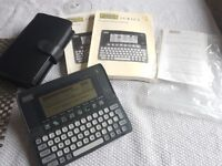Psion Series 3 vintage hand held PDA with Leather case, memory card, User Guide, Programming Manual.