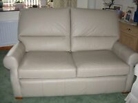 MULTIYORK TAUPE LEATHER SOFA. JUST OVER A YEAR OLD.