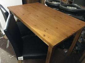 Solid wood oak stained table and 4 black chairs