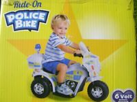 Ride on Electric Police Bike unusedstill in box with flashing blue light and headlight