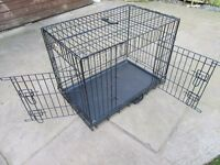 Folding dog cage, measures 76cm x 55cm x 47cm.