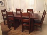 Solid wood dinning room table and 6 chairs