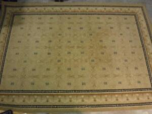 Carpet. Brown and beige with restrained motif. 100% Olefin. Made in Israel