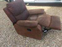 Brown Leather suede rocking reclining armchair. Can deliver.
