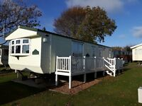 Caravan to rent/hire .Mersea Island Holiday Park. 2 bedroom caravan with en-suite, decking .