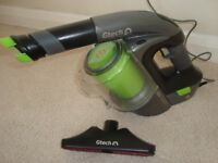 G TECH HAND HELD VACUUM WITH CHARGER AND BRUSHES