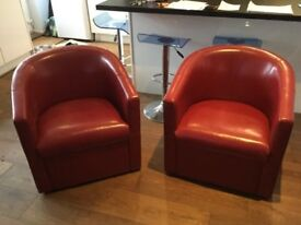 Red leather club chairs